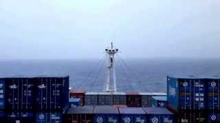 Cargo ship travel: Pitching on a calm sea