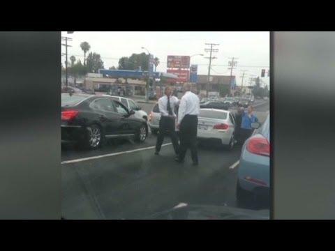 Men in business attire get into road rage fight