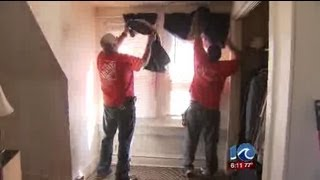 Home Depot employees renovating homes for veterans