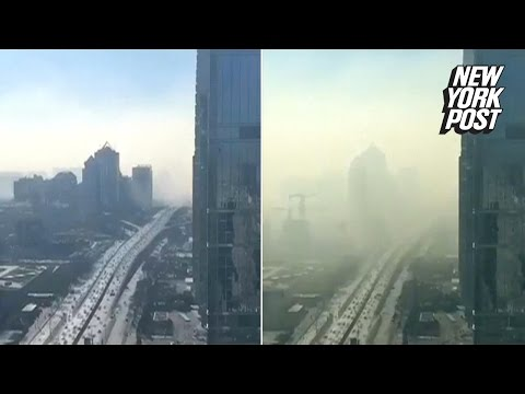 Camera catches horrifying cloud of smog rolling into Beijing