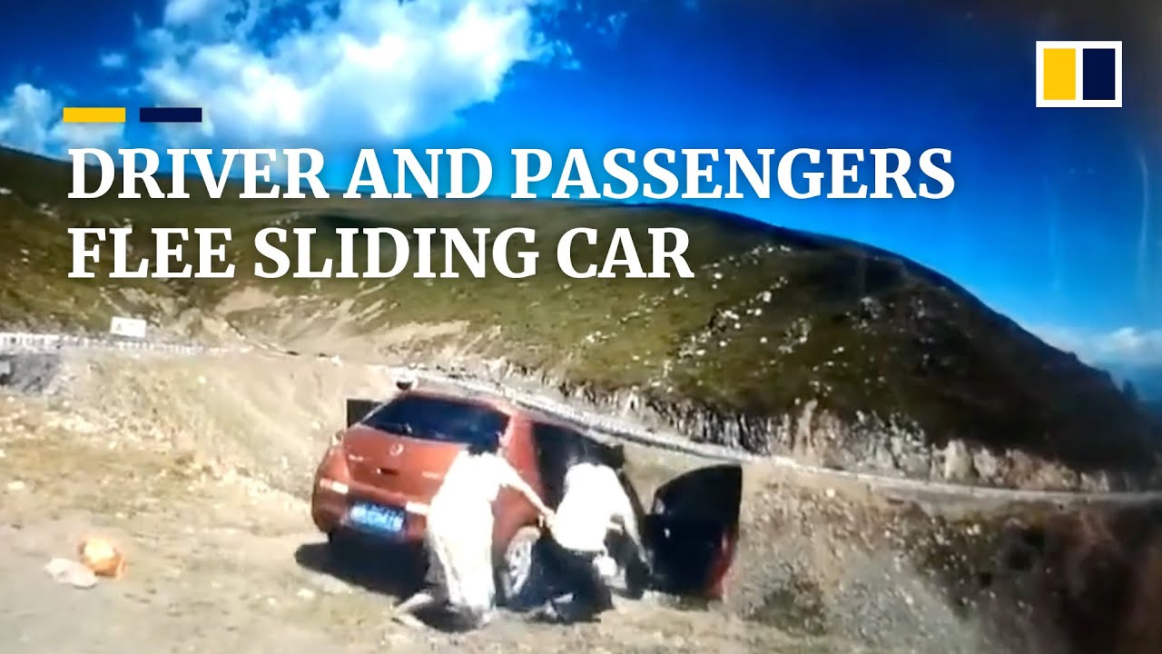 Driver, passengers flee car before it slides down mountain in China
