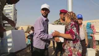 Syrians Fleeing To Iraq Find Food Across The Border
