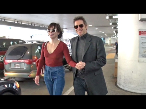 Milla Jovovich And Paul W. S. Anderson Look So In Love At LAX