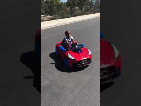 My baby brother riding Spiderman car