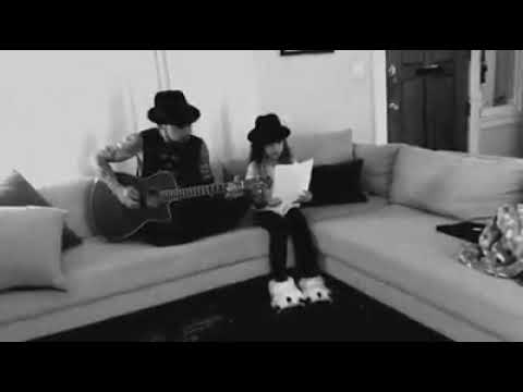 Dave Navarro and his goddaughter Lola performing Jane's Addiction
