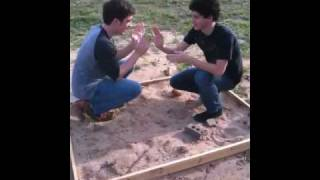 2 kids in a sandbox