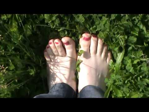 Walking barefoot with red nails