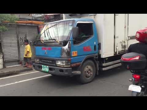 Streets of Manila, electrical wires and motorcycles