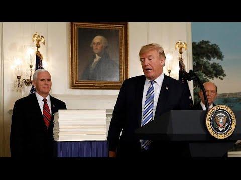 Download Youtube: President Donald Trump signs $1.3tn spending bill