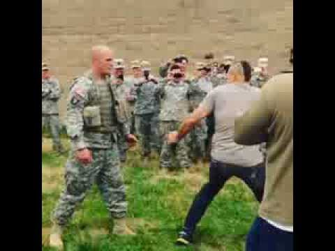 "Chuck ""The Iceman"" Liddell spin kicks an army soldier hard!"