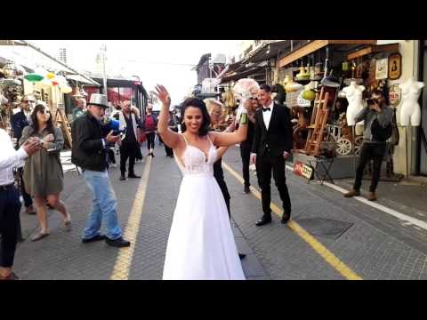 A Bride dancing at the flea market Jaffa-Tel Aviv, Israel. exciting. Very exciting