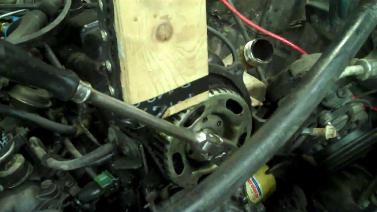how to remove a crankshaft or camshaft pulley sprocket using the old timing belt youtube [ 1280 x 720 Pixel ]