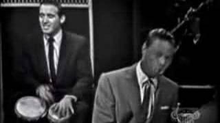 "Nat King Cole performing ""Caravan""."