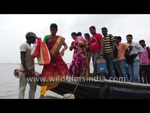 Passengers get down from a ferry at Gosaba island in Sundarbans, West Bengal