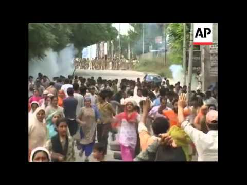 Protesters clash with police amid claims that gov't forces set Muslim shrine on fire