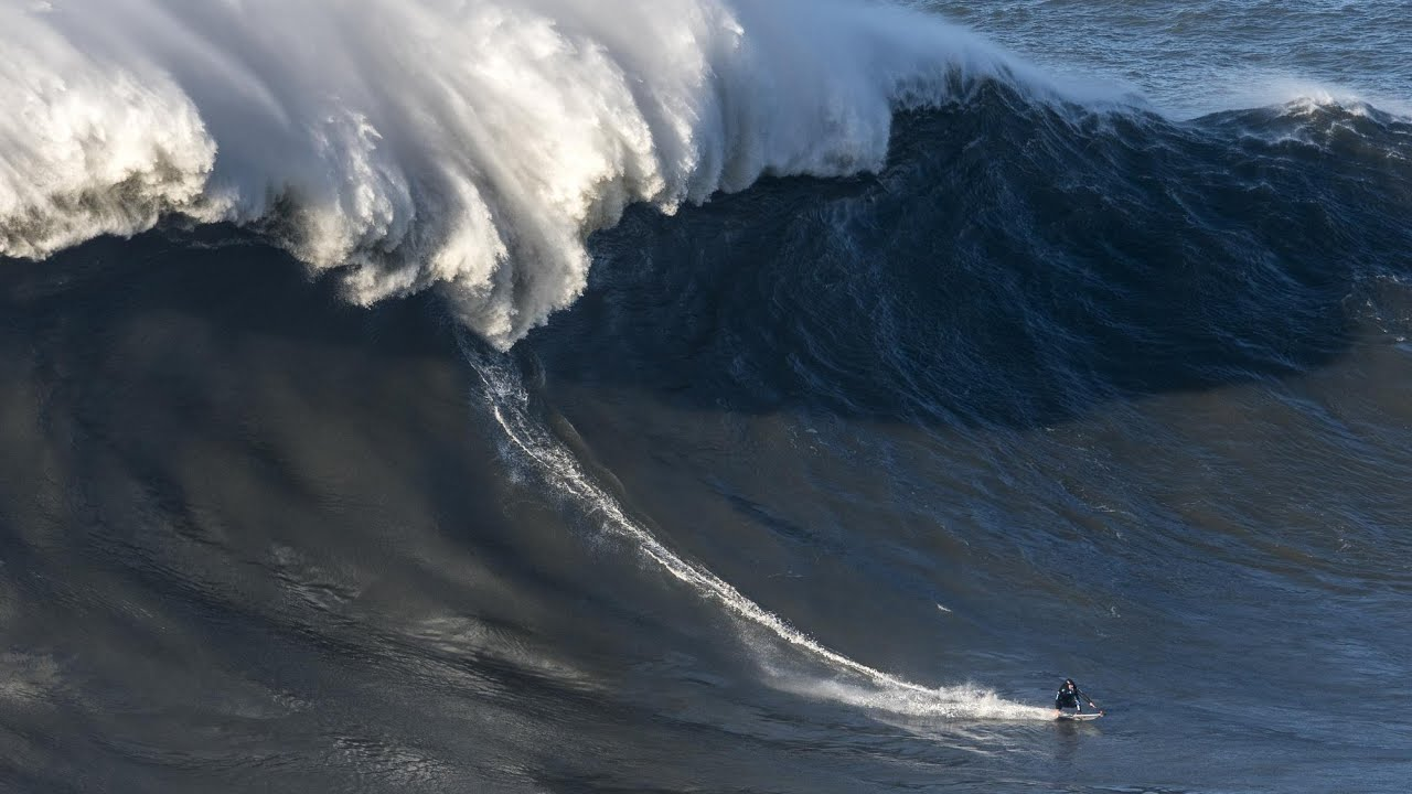 Giant Wave Slams Into British Surfer Andrew Cotton Causing Huge Wipeout