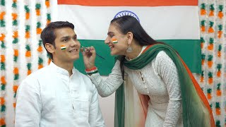 Indian girl painting a flag on the face of the young boy - national flag. Independence day concept