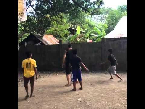 Marc Pingris playing with kids at their backyard in Pangasinan Pinoy Street Basketball