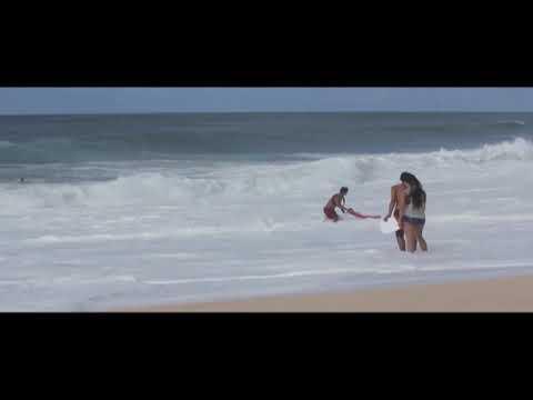 Lifeguard battles big surf in North Shore rescue