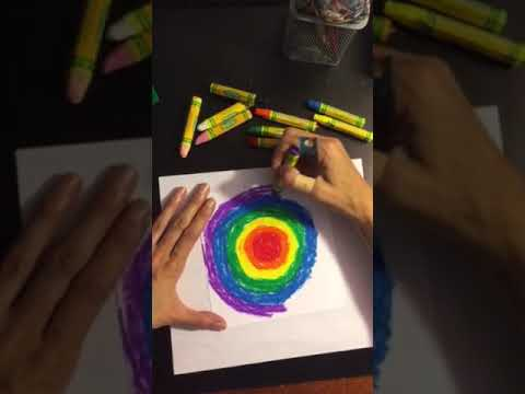 Tie dye on paper using oil pastels and an eraser