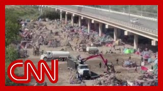 CNN reporter shows what has changed at mass migrant camp