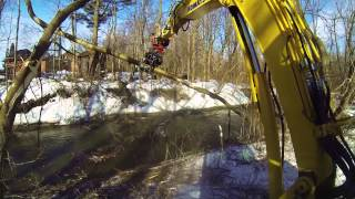 Video still for Rototilt and grapple in winter storm clean-up