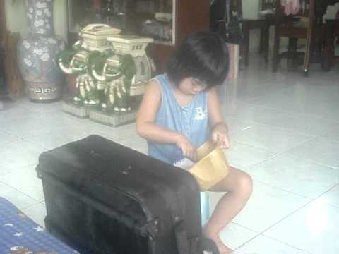 Marteena cleaning the luggage bag for vacation trip