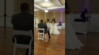 Wife sings to her husband at wedding accompanied by her little cousin on piano