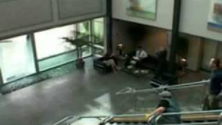 A Couple Of Idiots Allow A Cable Drum To Roll Through Door
