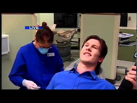 Joe Galli opens wide for cancer screening exam at Owens - YouTube