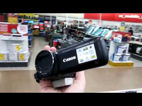 Видеокамеры в магазине на витрине. JVC, Sony, Panasonic, Canon.