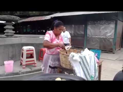 Women cooking outside of Antigua
