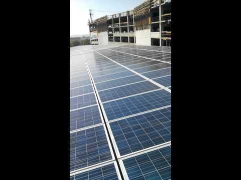 Pressure washing solar panels