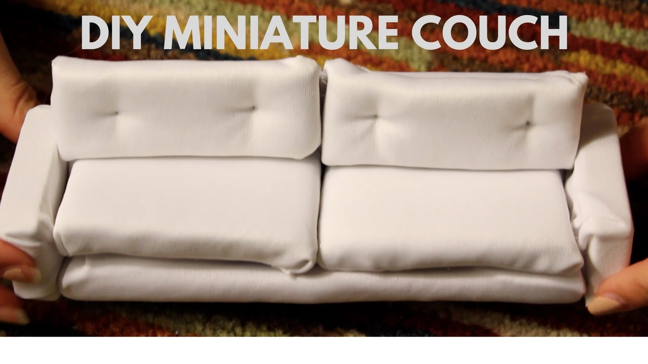 souvenirs on couch stock white isolated picture toys online miniature and background