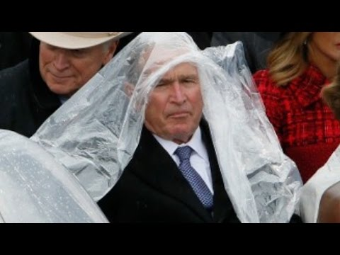 George W. Bush struggles with his poncho at Trump