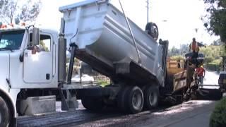 dump truck offloads asphalt // totally trucks dvds