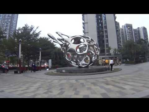 street in Shenzhen China - 2017 0112 - Jan12 - riding bicycle