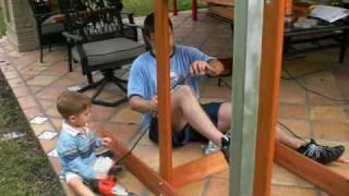 Ben Constructing Swing Set