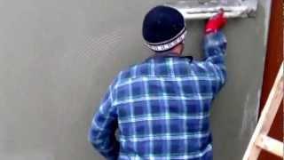 Ocieplanie Budynku-Zatapianie siatki Zbrojeniowej na styropianie.