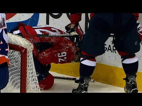 Kuznetsov slams into boards after getting tripped by Islanders