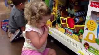 2 Year Old Playing With Toy Inside Walmart