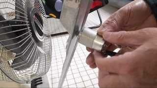 Testing a small dc motor for  AA battery charging in a wind turbine setup