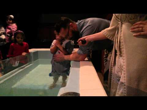 3 kids and there mother getting baptized