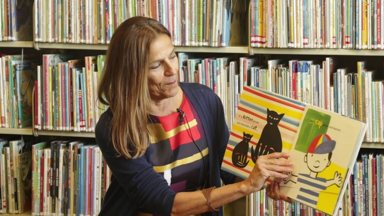 Children's Librarian reading a book aloud