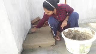 Indian women making mitti ka chulha  ||