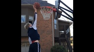 Another dunk on 10 feet at a friend's house in March 2014. I was 13...
