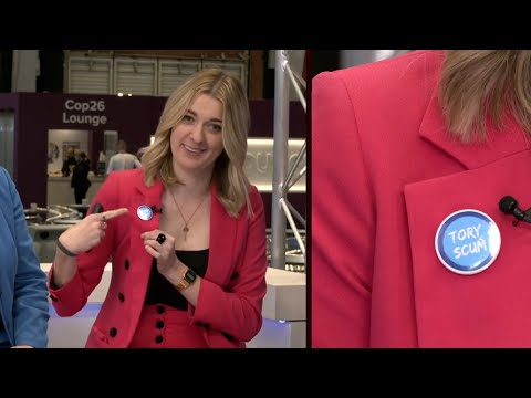 Dehenna Davison wears a Tory Scum badge at Conservative Party Conference