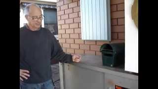Reuse Salvaged Metal Cabinet Under Carport For Storage