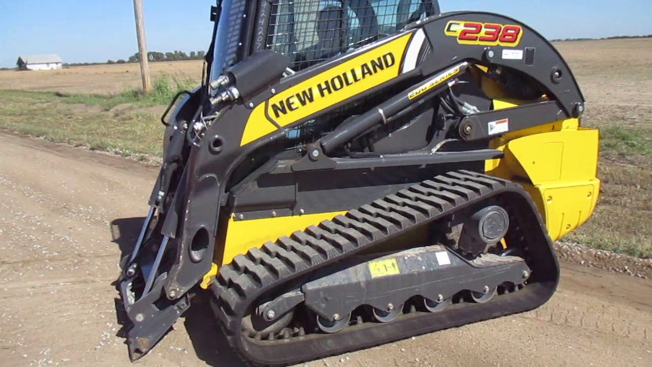 New Holland C238 Skid Steer And 84 Material Bucket