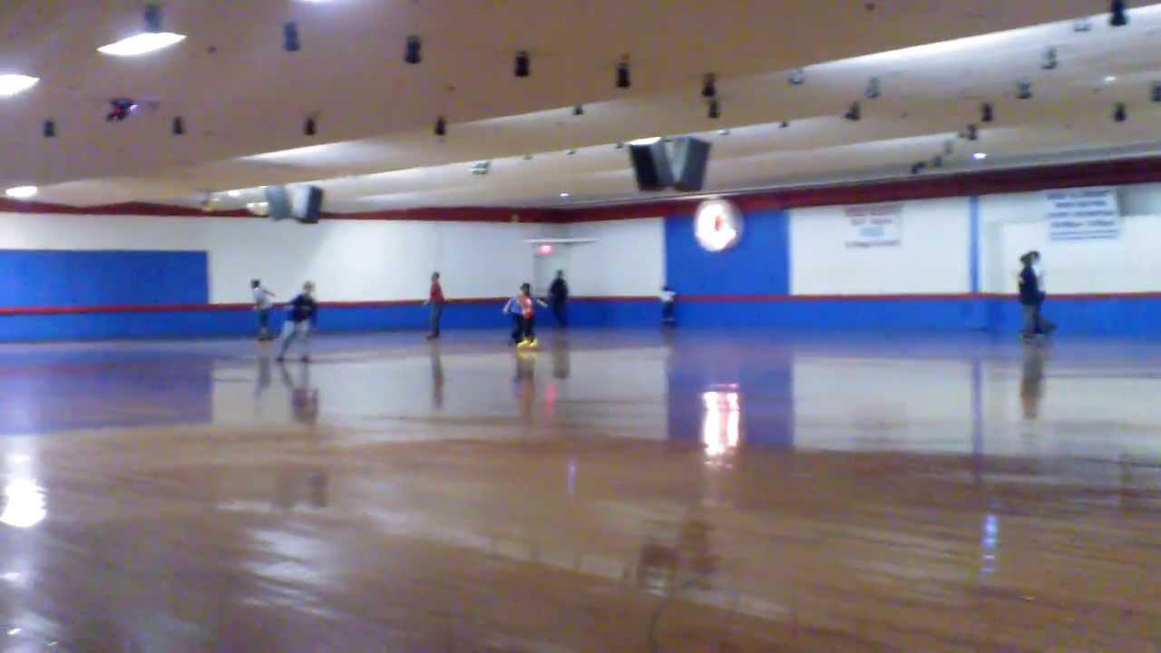 Collin 9 skating at kendall park roller rink